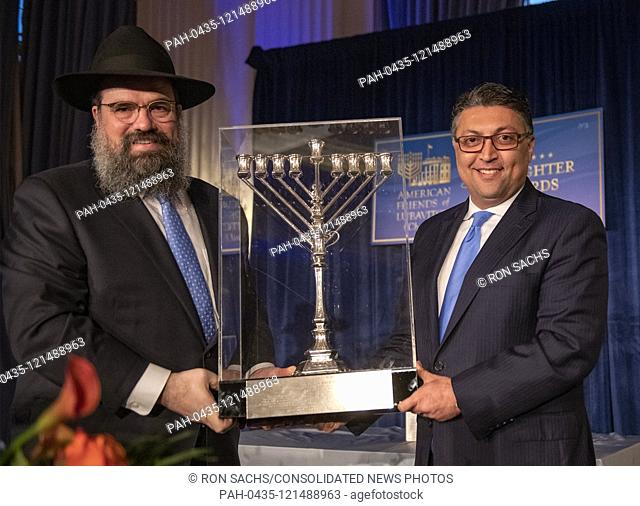 Makan Delrahim, Assistant Attorney General (Anti-Trust), United States Department of Justice, right, accepts the 2019 Lamplighter Special Friend Award from...