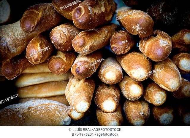 loaves and baguettes piled in a bakery