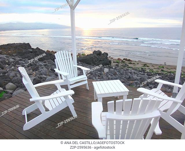 Outdoor furnitures Sunset in Santa Barbara beach Sao Miguel island Azores Portugal