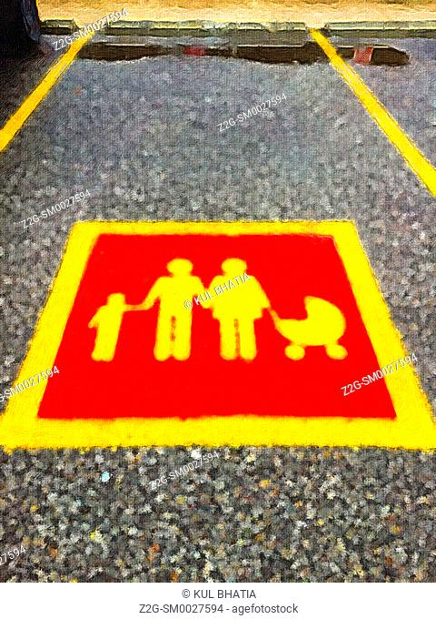 A sign for parking space reserved for families outside a modern shopping mall, Ontario, Canada