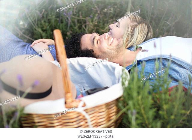 Young couple lying in lavender field