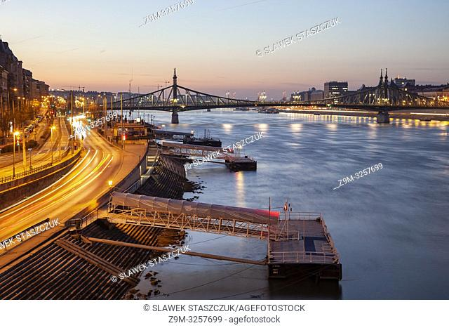 Dawn on the Danube in Budapest, Hungary. Freedom Bridge in the distance