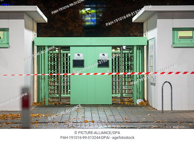16 October 2019, Saxony-Anhalt, Haldensleben: A barrier tape is stretched in front of the entrance to the Hermes dispatch centre site