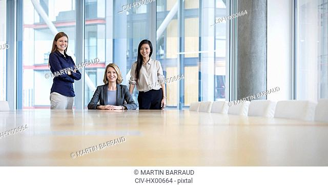 Surface level portrait confident businesswomen in conference room