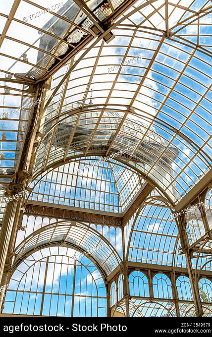 Madrid, Spain - November 2, 2018: Interior view of Crystal Palace, Palacio de Cristal, in Retiro Park. View against blue sky