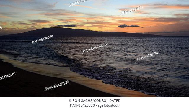 Sunset looking towards the Hawaiian island of Lanai from Kaanapali Beach, Maui, Hawaii on Thursday, February 23, 2017. Most of Lanai is owned by the tech...