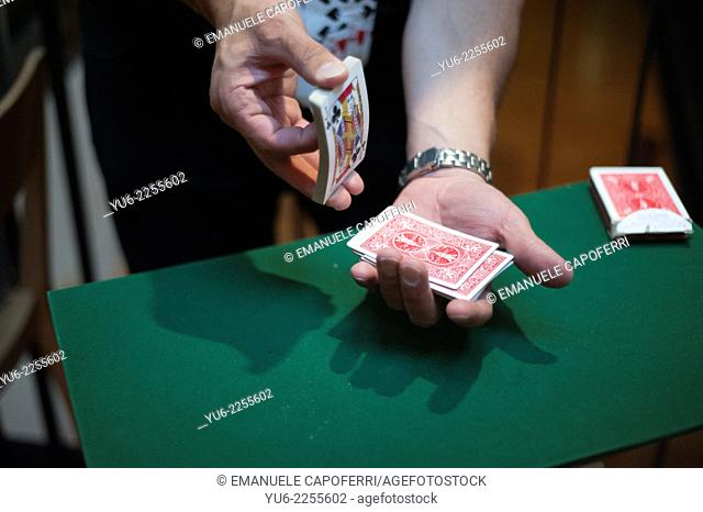 Magician with a deck of playing cards