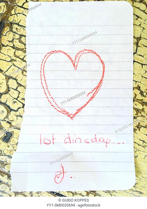 Tilburg, Netherlands. Drawn love note from one partner to another lying on his nightstand