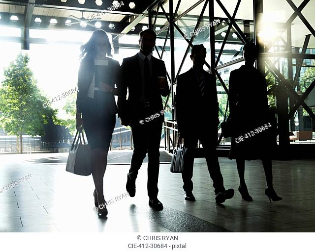 Corporate business people walking outside building