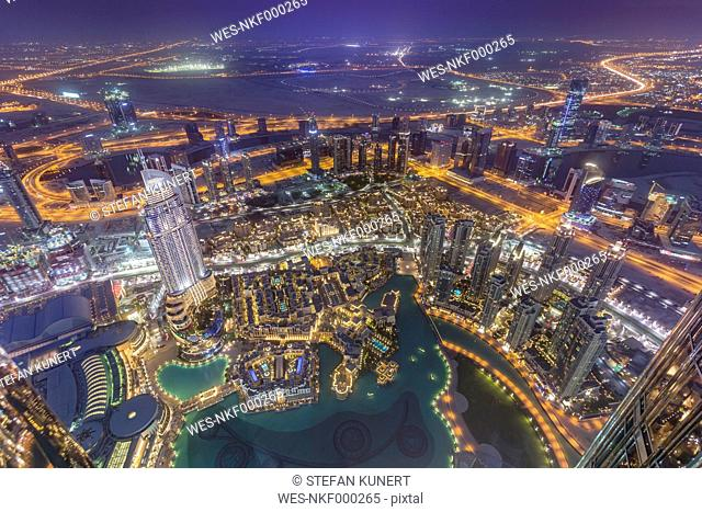 United Arab Emirates, Dubai, aerial view from the Burj Khalifa over Burj Khalifa Lake, Souk Al Bahar and the Dubai Creek at night