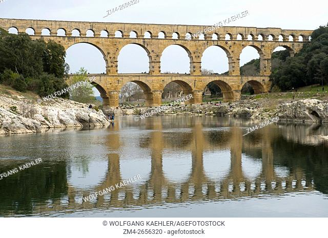 The Pont du Gard (UNESCO World Heritage Site) built in the first century AD is an ancient Roman aqueduct that crosses the Gardon River in the south of France...