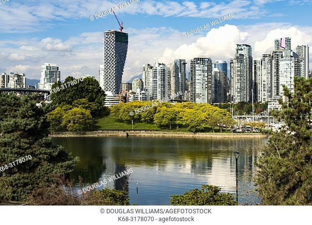 downtown skyline with Vancouver House on left, and Alder Bay and Granville Island in the foreground, Vancouver, BC, Canada