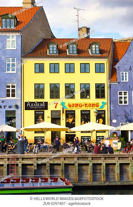 Pleasure Gentlemen's strip club and canalside alfresco tables and chairs, Nyhavn, Copenhagen, Denmark, Scandinavia. 17th century waterfront canal and...