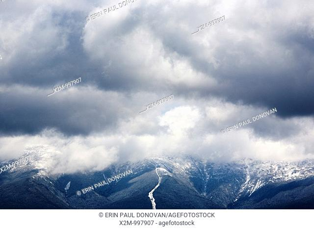 Mount Washington engulfed in storm clouds from the summit of Middle Sugarloaf Mountain during the spring months  Located in Bethlehem, New Hampshire USA