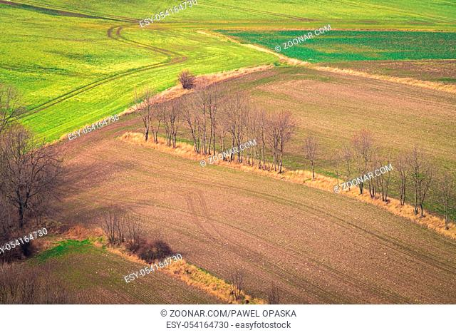 Aerial view of an empty field in winter among the rural landscape of Lower Silesia, Poland