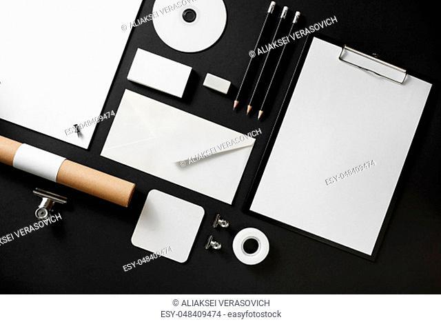 Blank corporate stationery set on black paper background. Branding mock up. Flat lay