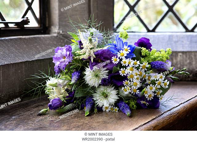 Close up of a bouquet of blue and white wedding flowers