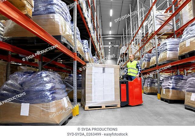 loader operating forklift at warehouse