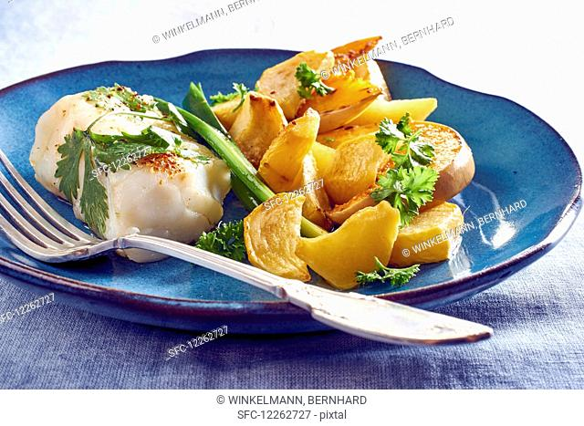 Cod fillet with pumpkin wedges and potatoes