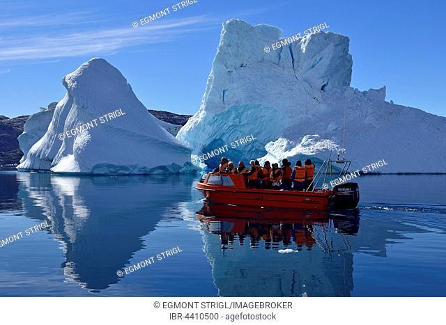 Tourist boat cruising through the icebergs, Sermilik Fjord, Kalaallit Nunaat, East Greenland
