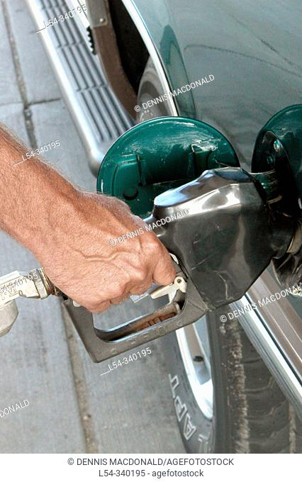 Hand pumping gas