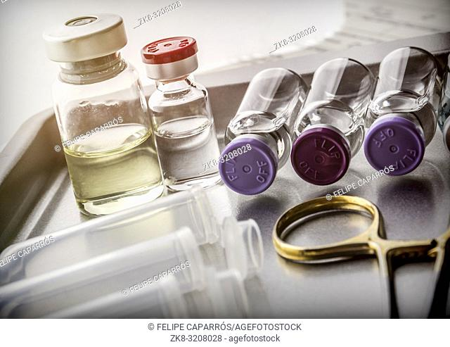 Scissors and vials in a table of operating room of a hospital, conceptual image