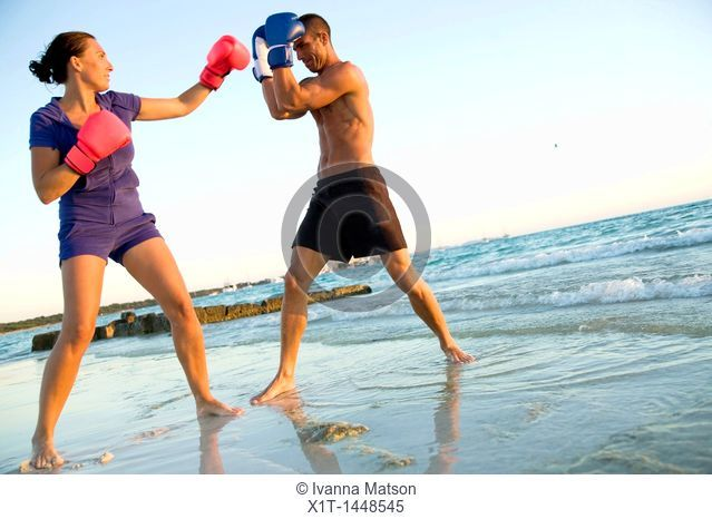 Couple boxing on the beach