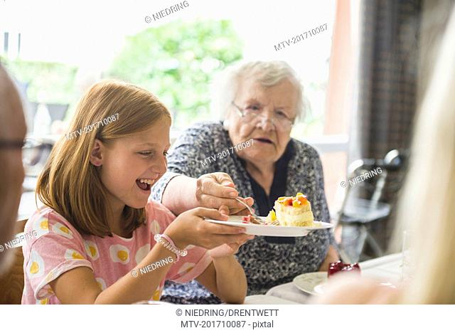 Family eating cake at rest home