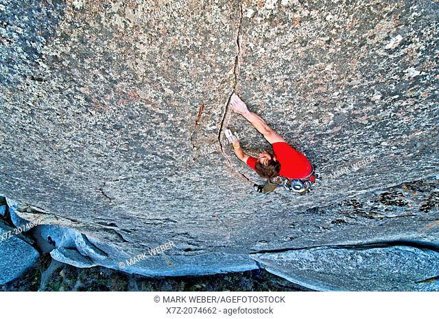 Man rock climbing a route called Beware Of Nesting Egos which is rated 5, 11 and located on Elephant Rock at the City Of Rocks National Reserve near the town of...