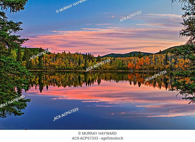 Sibbald Lake as seen in the fall at sunrise. Nice reflections of the sky and trees in the water