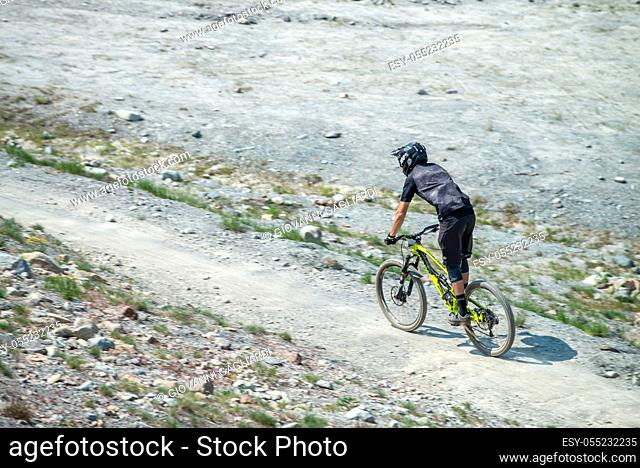 WHISTLER, CANADA - AUGUST 12, 2017: Man rides his mountain bike down Whistler Mountain during the summer season. Whistler mountain is converted to a mountain...