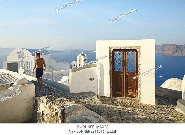Tourist looking at view, Santorini, Greece