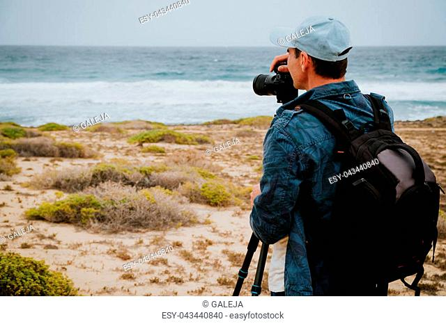 Photographer takes a picture of ocean brakers and waves on Sao Vicente Island Cape Verde