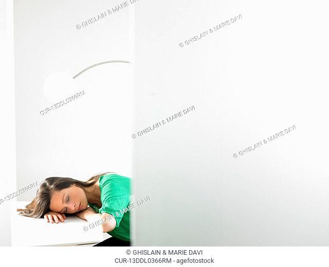 Woman sleeping on her desk