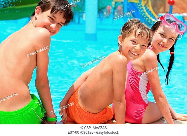 Happy siblings by pool