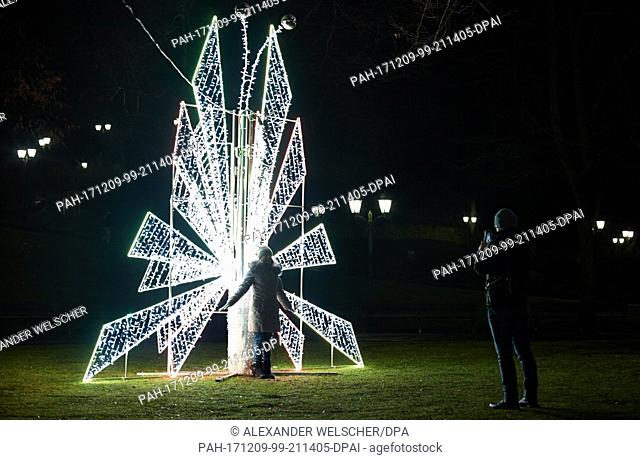 """Spectators gate at the different Christmas tree variations and sculptures in Riga, Latvia, 8 December 2017. The """"""""road of Christmas Trees""""""""is set up annually..."""