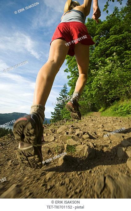 Runner on rocky trail