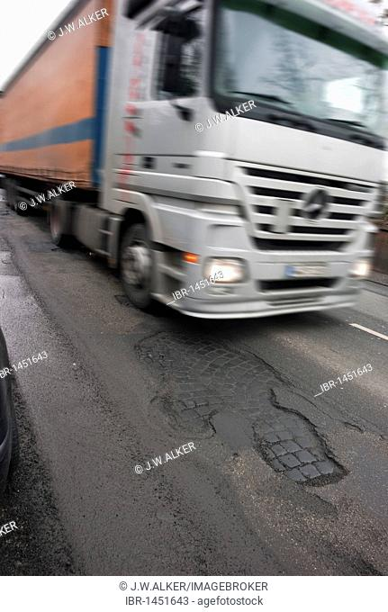 Frost damage, potholes in the road surface, Germany