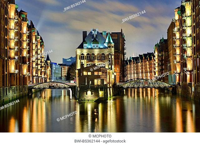 illuminated warehouse district with castle and canal, Germany, Hamburg
