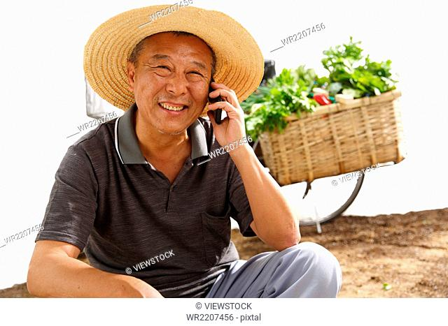 Farmers make a phone call