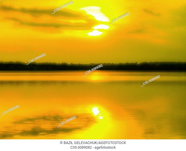 sunset on the river is photographed with a monocle