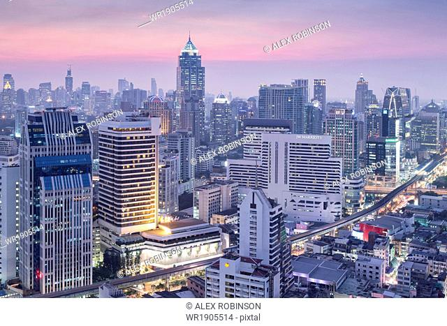 City skyline looking along the BTS Skytrain, Sukhumvit Road and Phloen Chit to Phloen Chit station, Bangkok, Thailand, Southeast Asia, Asia