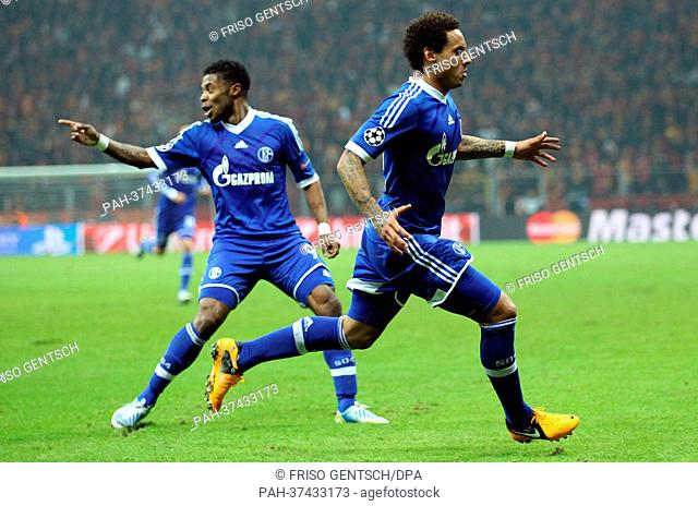 Jermaine Jones (R) of Schalke celebrates his goal for 1-1 with Michel Bastos (L) during the UEFA Champions League round of 16 first leg soccer match between...