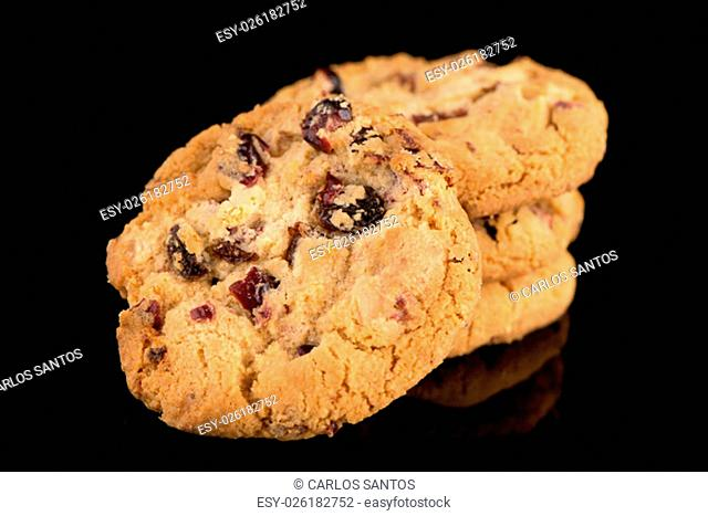 Dried fruits chip cookies isolated on black background