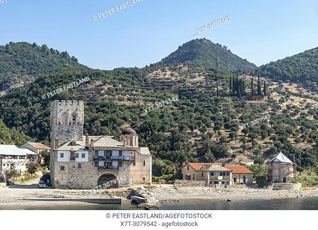 The old tower at the landing point for Zografou Monastery on the Southwest coast of the Athos peninsula, Macedonia, Northern Greece