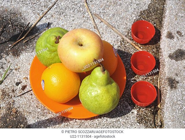 Malacca (Malaysia): offerings (fruit, wine) on a grave in the Jelutong Melaka cemetery, during the Ching Ming Chinese commemoration of the ancestors