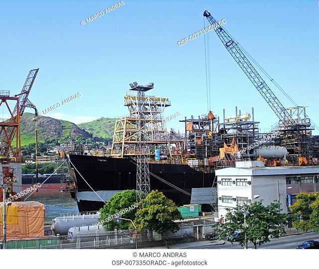 some crane machines working at vitoria harbor
