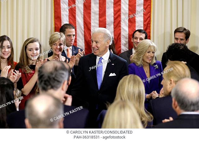 United States Vice President Joe Biden, with his wife Jill Biden celebrate after taking the oath of office from Supreme Court Justice Sonia Sotomayor surrounded...