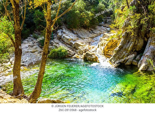 Emerald green water at the river Borosa in the Nature Park Sierra de Cazorla, Andalusia Spain