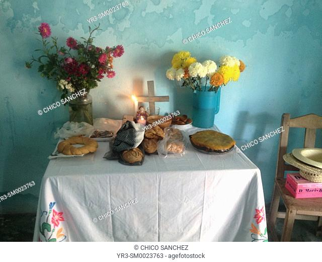 An altar for the Day of the Dead with flowers and food in Pomuch, Campeche, Yucatan Peninsula, Mexico